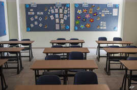 FILE - Image of an empty classroom at a Christian school.