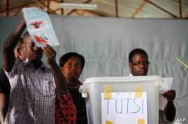 FILE - Pollling officials distinguish votes between Hutus and Tutsis in Burundi's capital, Bujumbura, July 28, 2010.