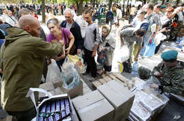 Volunteers share food and water for residents in the town of Luhansk, eastern Ukraine, Sept. 14, 2014