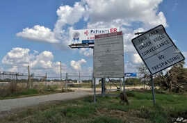 The entrance to the San Jacinto River Waste Pits site is seen, Sept. 29, 2017, in Channelview, Texas.