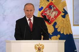 Russian President Vladimir Putin gives his annual state of the nation address in the Kremlin in Moscow, Dec. 1, 2016.