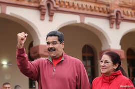 Venezuela's President Nicolas Maduro greets supporters with his wife Cilia Flores during an appearance at a military base in Caracas, Dec. 8, 2016.