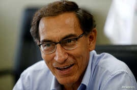 FILE - Peru's Vice President Martin Vizcarra talks during an interview with Reuters at his office in Lima, March 31, 2017.