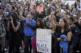 FILE - University California Los Angeles students stage a protest rally in a show of solidarity with protesters at the University of Missouri, Thursday, Nov. 12, 2015 in Los Angeles.