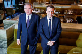 Emmanuel Macron, (R) head of the political movement En Marche !, or Onwards !, candidate for the 2017 presidential election, and Francois Bayrou, French centrist politician and the leader of the Democratic Movement (MoDem), arrive for a news conferen