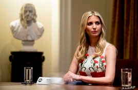 FILE - Ivanka Trump, the daughter of President Donald Trump, attends a meeting with President Donald Trump in the Cabinet Room of the White House, July 17, 2018, in Washington.
