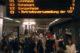 FILE - Passengers wait at the Hauptwache rail station in downtown Frankfurt, Germany.