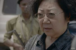Yang Feng Lan is seen after her arrest on charges for trafficking in ivory. (Elephant Action League)