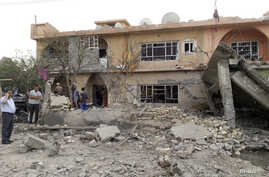 Residents gather at the site of a bomb attack in the town of Tuz Khurmatu, north of Baghdad, Oct. 31, 2013.