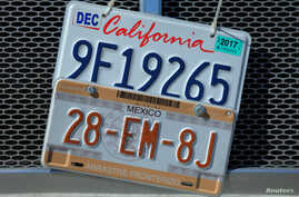 A transport truck displaying California and Mexico license plates is parked on a street in Otay Mesa, California, Jan. 27, 2017.