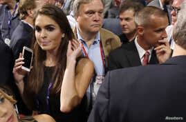 FILE - Republican U.S. Presidential candidate Donald Trump's communications director Hope Hicks (L) crosses paths with Trump's former campaign manager Corey Lewandowski (R) at the Republican National Convention in Cleveland, Ohio.
