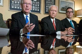 From left, Senate Majority Leader Mitch McConnell, R-Ky., Senate Finance Committee Chairman Orrin Hatch, R-Utah, and Treasury Secretary Steven Mnuchin speak to reporters as work gets underway on the Senate's version of the GOP tax reform bill, on Cap