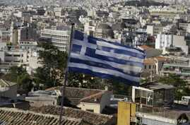 A Greek national flag flies in the city of Athens, May 8, 2015.