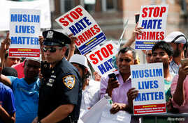 Community members take part in a protest to demand stop hate crime during the funeral service of Imam Maulama Akonjee, and Thara Uddin in the Queens borough of New York City, Aug. 15, 2016.