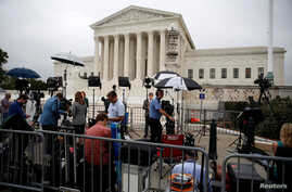 Members of the media report on the first day with newly sworn in Associate Justice Brett Kavanaugh on the court at the Supreme Court in Washington, Oct.  9, 2018.