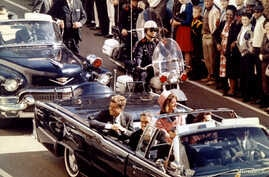 President John F. Kennedy and Mrs. John F. Kennedy, and Texas Governor John Connally ride through Dallas moments before Kennedy was assassinated, November 22, 1963 3333333
