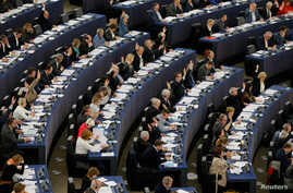 Members of the European Parliament take part in a voting session in Strasbourg, France, April 14, 2016. MEPs voted on Thursday on the EU Passenger Name Record (PNR) Directive, which would oblige airlines to hand EU countries their passengers' data in