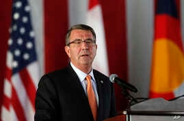 """FILE - Defense Secretary Ash Carter speaks during a change of command ceremony at Peterson Air Force Base, in Colorado Springs, Colorado, May 13, 2016. Carter says says military spending legislation in Congress """"undercuts stable planning and efficien"""