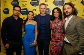 "Michael Pena, America Ferrera, Gabriel Mann, Rosario Dawson and director Diego Luna arrive at the North American premiere of their film ""Cesar Chavez"" during the SXSW Film Festival on March 10, 2014, in Austin, Texas."