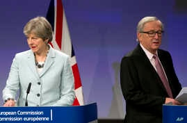 British Prime Minister Theresa May, left, and European Commission President Jean-Claude Juncker prepare to address a media conference at EU headquarters in Brussels on Dec. 8, 2017.