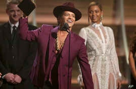 """FILE - Bruno Mars accepts the award for record of the year for """"Uptown Funk"""" at the 58th annual Grammy Awards in Los Angeles."""