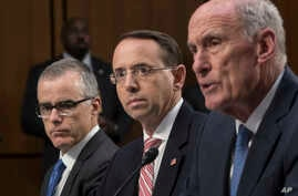 From left, acting FBI Director Andrew McCabe, Deputy Attorney General Rod Rosenstein, and Director of National Intelligence Dan Coats, testify before a Senate Intelligence Committee hearing about the Foreign Intelligence Surveillance Act, on Capitol