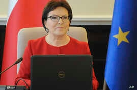 Polish Prime Minister Ewa Kopacz opens a meeting of her cabinet in Warsaw, Poland, October 20, 2015.