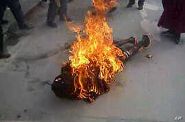 This still image allegedly shows the self-immolation of an individual along a street in Dawu, Ganzi prefecture in Sichuan province. The dramatic video footage, could not be independently verified, purportedly captures the moment a Tibetan Buddhist nu