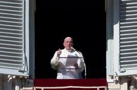 Pope Francis delivers a message during his Angelus prayer from his studio window overlooking St. Peter's Square, at the Vatican, Nov. 8, 2015.