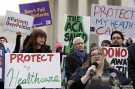 FILE - Laura Hayes, with microphone, of Fort Wayne, Indiana, tells fellow protesters how the Affordable Care Act helped her with health costs, during a protest in front of the Supreme Court in Washington, March 4, 2015.
