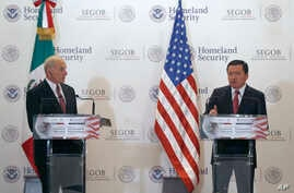 U.S. Homeland Security Secretary John Kelly, left, listens to Mexico's Interior Secretary Miguel Angel Osorio Chong as he gives a statement to the press after Kelly's visit in Mexico City, July 7, 2017.
