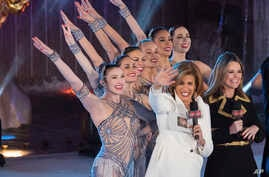FILE - In this Nov. 29, 2017, file photo, Savannah Guthrie, right, and Hoda Kotb appear with the Rockettes during the 85th annual Rockefeller Center Christmas Tree lighting ceremony in New York. NBC News opened the new year by appointing Kotb as co-a