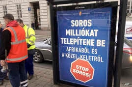 FILE -  A poster in Budapest reads 'Soros would settle millions from Africa and the Middle East. Stop Soros!,' Feb. 1, 2018.