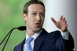 FILE - Facebook CEO Mark Zuckerberg speaks at Harvard University  in Cambridge, Mass., May 25, 2017.