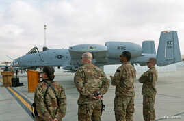 U.S air force personnel stand by an U.S. A-10 aircraft, one of a squadron that arrived at the Kandahar air base, Afghanistan, Jan. 23, 2018.
