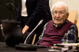 FILE - Former SS officer Oskar Groening waits in a courtroom in Lueneburg, northern Germany, Wednesday July 8, 2015.