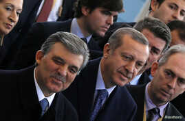 Turkish President Abdullah Gul (L) and Prime Minister Tayyip Erdogan (C) arrive at the opening ceremony of a new line of the Ankara Metro, in Ankara Turkey, Feb. 12, 2014.