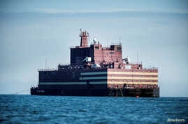 "The Russian ""Academy Lomonosov,"" the world's first floating nuclear power plant, passes Langeland island, while heading for Murmansk in northwestern Russia, May 4, 2018. China plans to power some of its claimed islets in the South China Sea with flo"