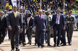President Omar al-Bashir of Sudan, center, arrives for the inauguration ceremony of Uganda's long-time president Yoweri Museveni in the capital Kampala, May 12, 2016.
