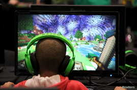 A child plays video game Minecraft in London, July 4, 2015.
