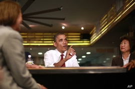 President Barack Obama participates in a roundtable discussion with local small business owners at Taylor Gourmet in the U Street neighborhood in Washington, May 16, 2012.