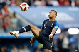 France's Kylian Mbappe controls the ball during the semifinal match between France and Belgium at the 2018 soccer World Cup in St. Petersburg, Russia, July 10, 2018.