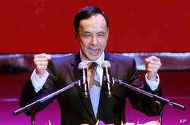 Taiwan's ruling Nationalist Party chairman and presidential candidate in the 2016 elections, Eric Chu, gestures during an extraordinary party congress in Taipei, Taiwan, Saturday, Oct. 17, 2015.