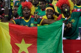 Cameroon's supporters chant ahead of the African Cup of Nations Group A soccer match between Cameroon and Gabon at the Stade de l'Amitie, in Libreville, Gabon, Sunday, Jan. 22, 2017.