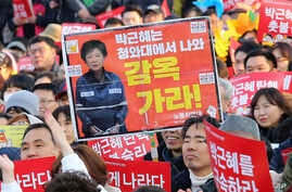 Protesters attend a rally calling for impeached President Park Geun-hye's arrest in Seoul, South Korea, March 11, 2017.