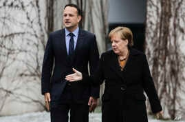 German Chancellor Angela Merkel, right, welcomes the Prime Minister of Ireland, Leo Varadkar for talks at the chancellery in Berlin, Germany, March 20, 2018.