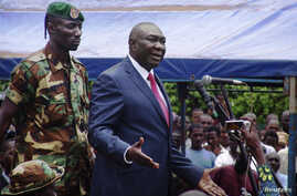 Central African Republic's new President Michel Djotodia speaks to his supporters at a rally in favor of the Seleka rebel coalition in downtown Bangui Mar. 30, 2013.