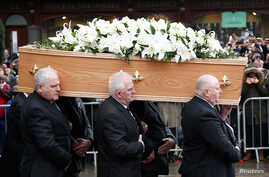 Pallbearers carry the coffin holding the remains of theoretical physicist Stephen Hawking out of Great St. Mary's Church at the conclusion of his funeral service, in Cambridge, Britain, March 31, 2018.