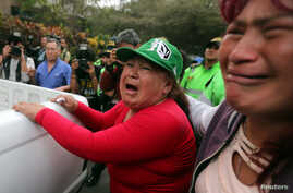 Supporters of former President Alberto Fujimori react outside his residence after a judge annulled a presidential pardon and ordered his immediate capture and return to prison, in Lima, Peru Oct. 3, 2018.