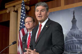 Sen. Joe Manchin, D-W.Va., right, accompanied by Sen. Patrick Toomey, R-Pa., announce that they have reached a bipartisan deal on expanding background checks to more gun buyers, Wednesday, April 10, 2013, on Capitol Hill in Washington.